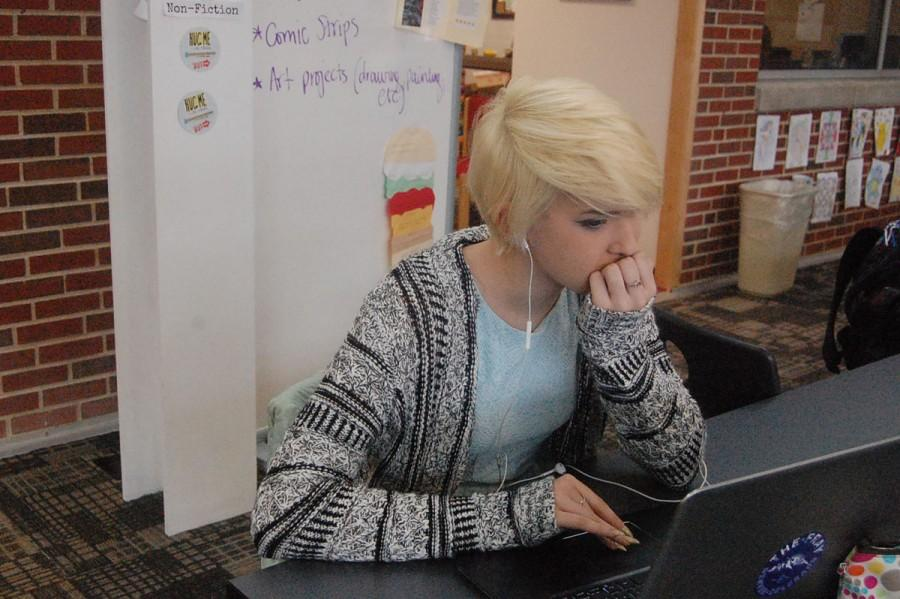 Junior Catherine Johnson listens to K-Pop on Jan. 13.  Johnson is saving up money to see her favorite K-Pop band live.