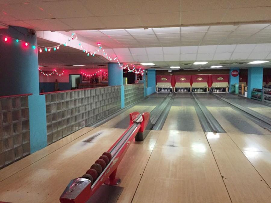 """In duckpin bowling, everything is scaled to a smaller size than in the normal version. """"Strikes and spares are very rare in this game,"""" employee Thom Dantzer said.  Photo by Madeline Hittel"""