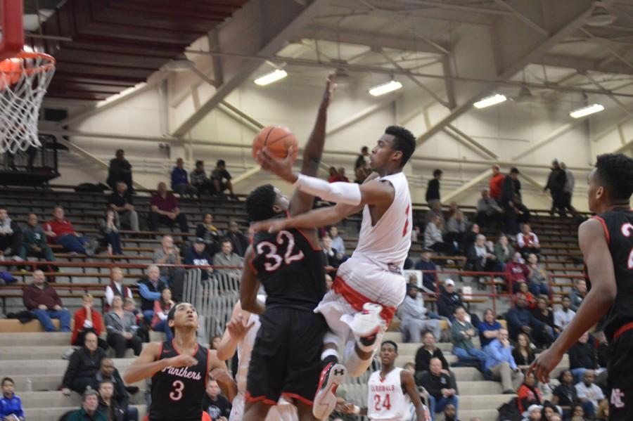 Junior Paul Scruggs goes up for a layup with a defender in his face in a game against North Central on Jan. 13. Scruggs finished as the player of the game with 20 points and 8 rebounds.