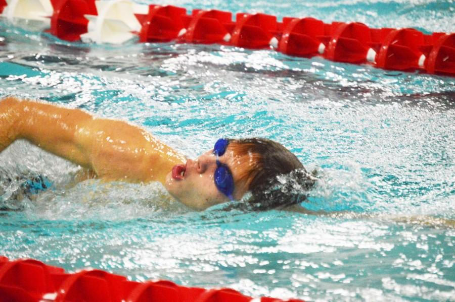 Sophomore Scott Speiser comes up for air on Senior Night. Speiser joined swimming to enhance his running abilities.