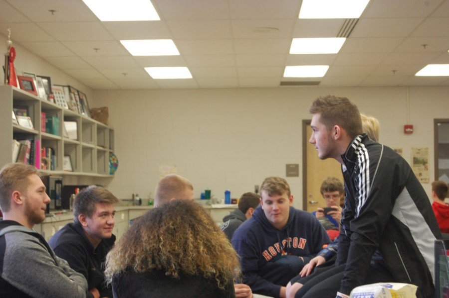 Junior Ethan Vanover (far left) and his brother, freshman Jack Vanover sit in ipass on Monday, Jan. 25. and talk with friends. Photo by Rae Updike