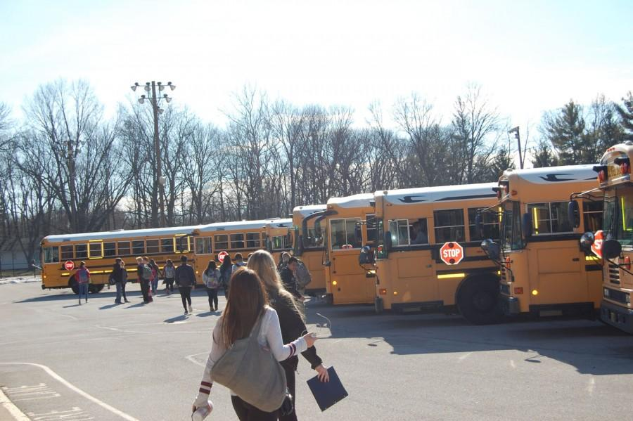 SHS students walk to their buses after dismissal.
