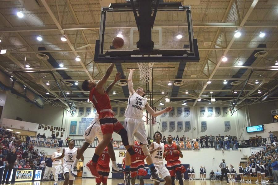 Junior Paul Scruggs goes up against a Perry Meridian defender on Feb. 4.
