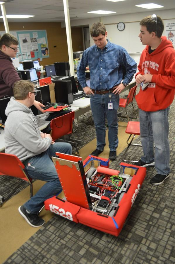Cyber Cards work on their robot during build season. Senior Cyber Cards play an instrumental role in helping the team build their robot.
