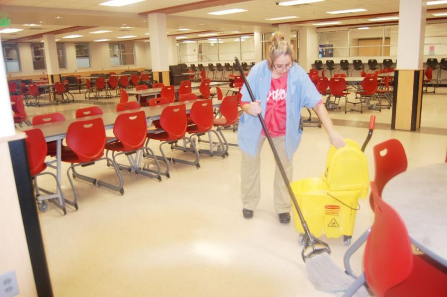 Custodian+Sherry+Henry+mops+the+cafeteria+floor+on+Feb.+4.+Henry+has+worked+at+SHS+for+16+years.