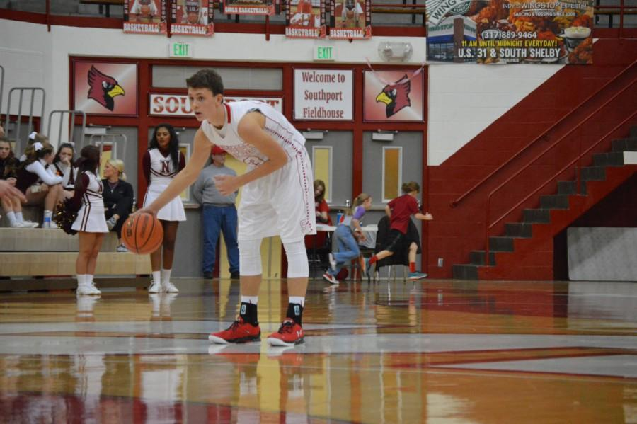 Freshman Chaz Hindz dribbles at half court. Hindz plays JV basketball at SHS and for the travel team Indiana Elite.