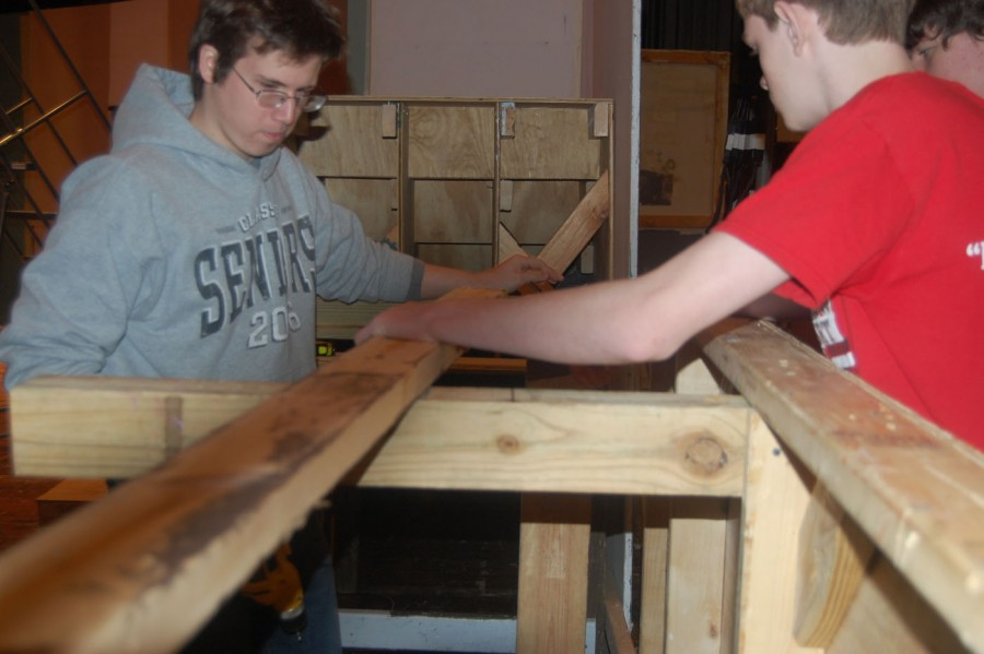 Senior Dave Smith builds structure while assisting others.