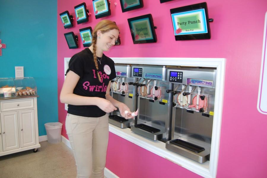 Senior Alexis Burton gets a sample of frozen yogurt for a customer at Ella's Frozen Yogurt on Feb., 6. Burton once had to clean up fecal matter while working.