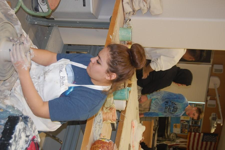 Senior Maria Rojas works on her project in Ceramics on Wednesday, Feb. 17.