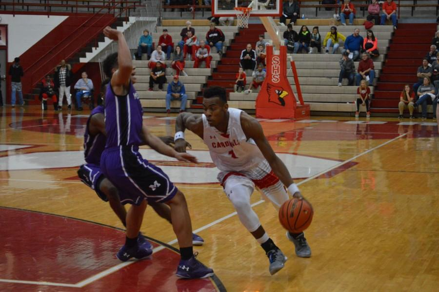Junior Paul Scruggs drives past a Merrilville defender on Nov. 28. Scruggs has been averaging 19.8 points per game and will play a pivotal role in sectionals.