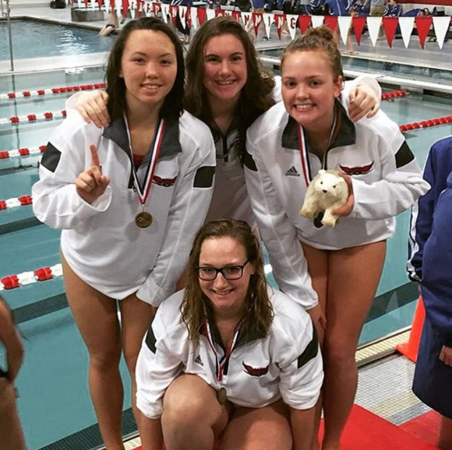 The+200+meter+medley+relay+team+poses+for+a+photo+after+setting+a+new+record+of+1%3A59%3A02.