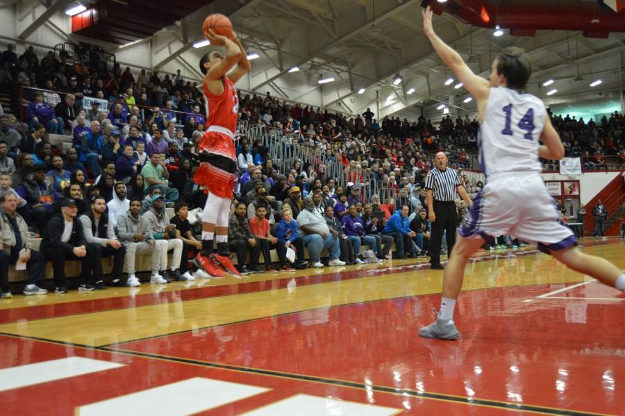 Senior David Reyes shoots a 3-pointer in the sectional championship against Ben Davis. After being bench for a majority of the first half of the season, Reyes has emerged as an impact player.