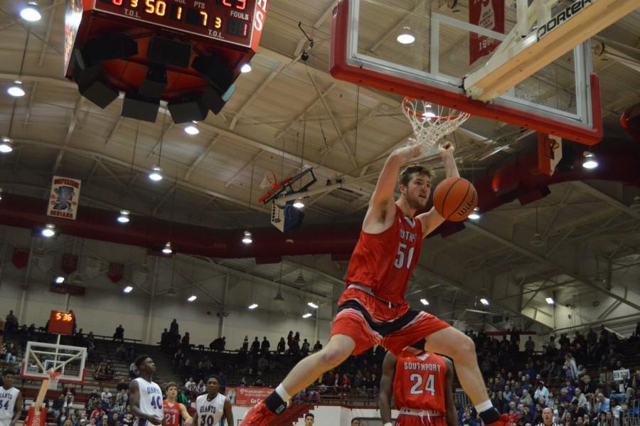 Senior Joey Brunk dunks the ball against Ben Davis.