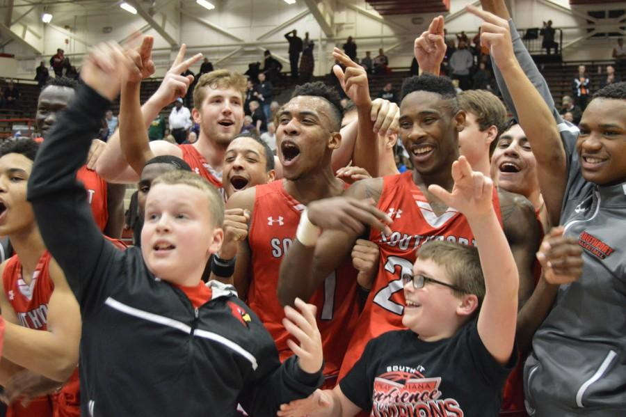 The+boys+basketball+team+celebrates+after+winning+the+sectional+championship+for+the+first+time+in+16+years.