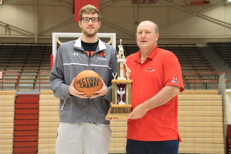 Joe and his son, senior Joey Brunk, posed with a sectional trophy and game ball. The father-son duo won their titles 39 years apart.