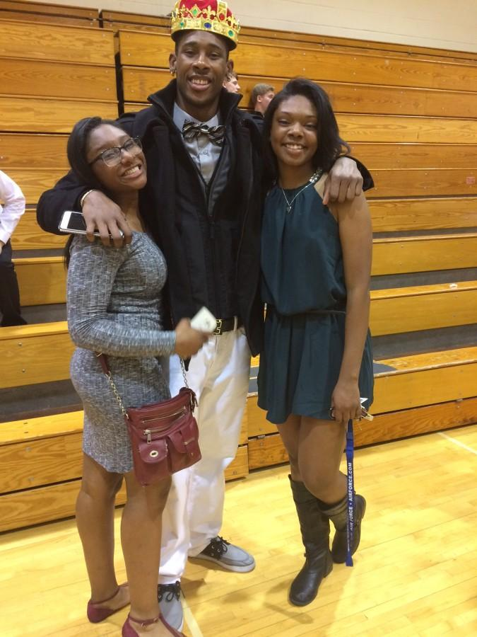 Senior Eli Walton and friends celebrate his  Snowcoming King crown in the East gym on Saturday, Feb. 27.