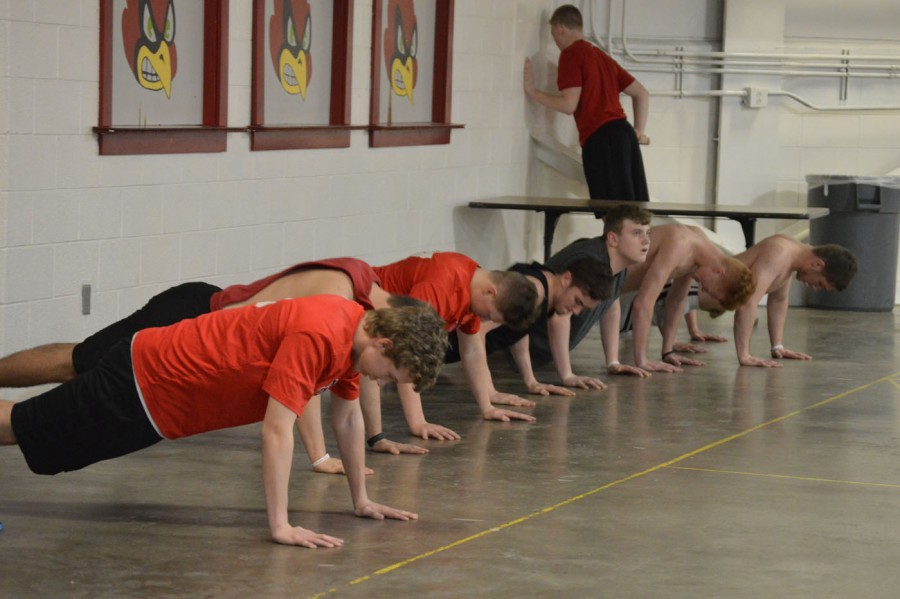Baseball players do push-ups as part of a circuit at Stotan.