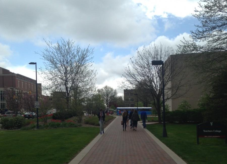 College students walk the campus of Ball State University on Friday, April 22.