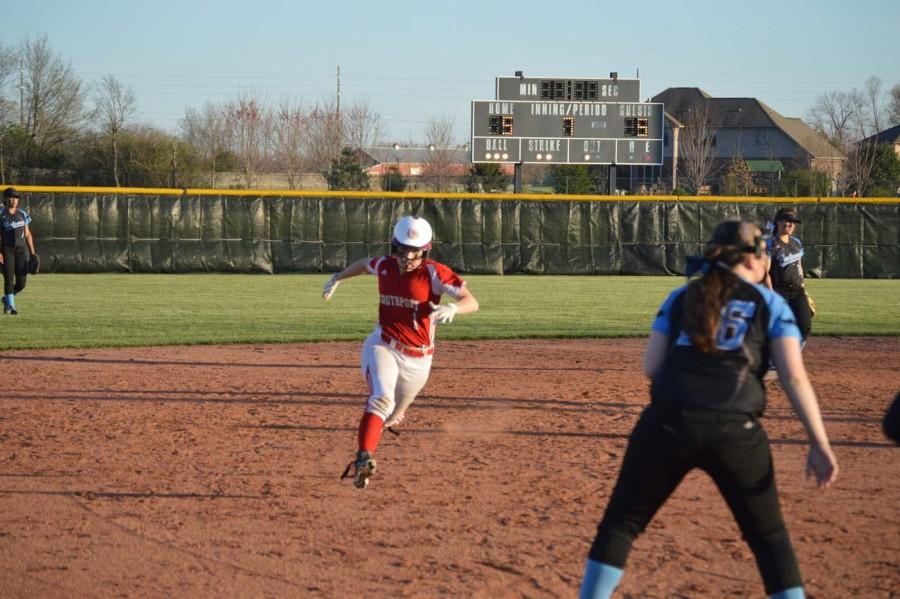 Senior Brooke Lightfoot gets ready to dive into third base.