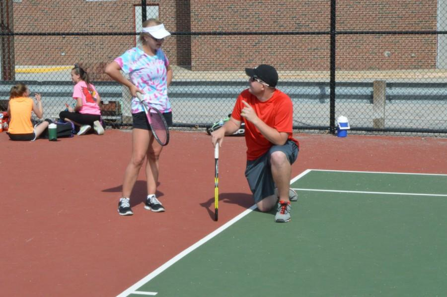 First-year+tennis+coach+Jordan+Cross+talks+to+senior+Kaileigh+Thomas%2C+who+has+been+on+the+team+for+four+years.+Thomas+says+she+wishes+she+had+Cross+as+a+coach+the+last+three+seasons.++