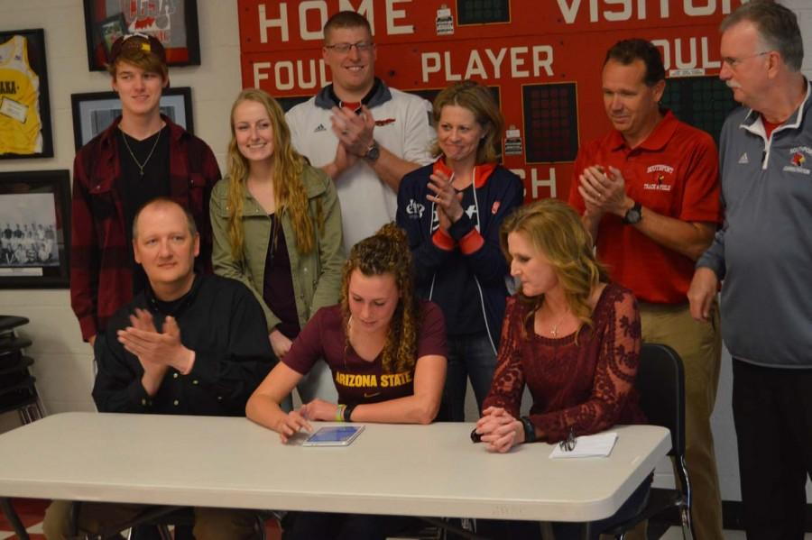 Senior Delany Bucker sits with her close friends and family as she signs to Arizona State University on April 13. Bucker will be attending Arizona State to participate in the triathlon.
