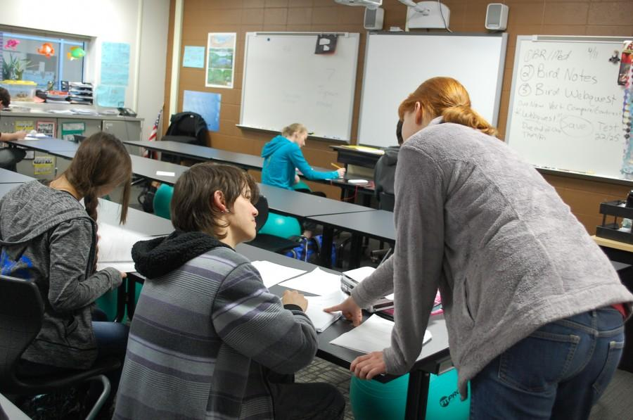 Science teacher Rachel Pierce helps students during a class on April 12, 2016.