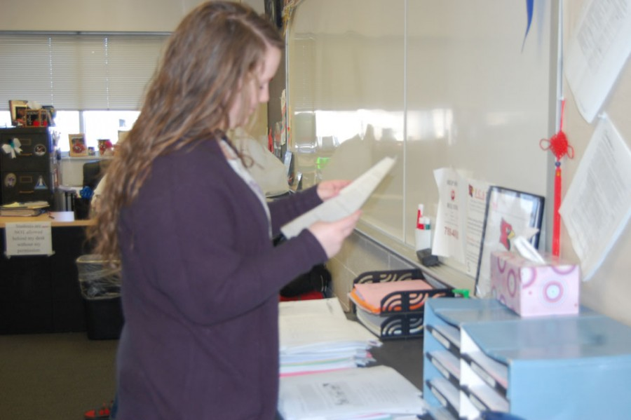 Senior Emily Kendrick is putting papers away during Ipass on April 12, 2016.