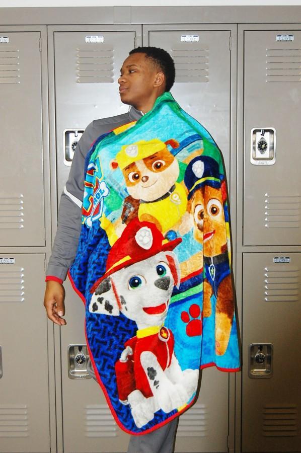 When at school, Junior Jason Dockery wears his good-luck blanket around his neck.