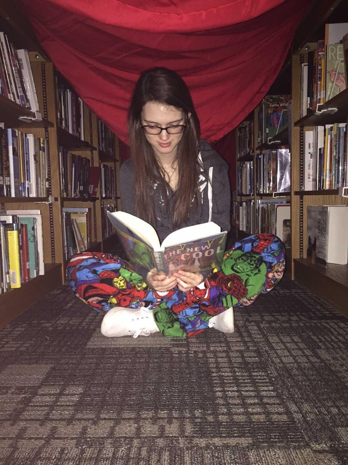 Freshman Victoria Fitzgerald is reading the IMC.