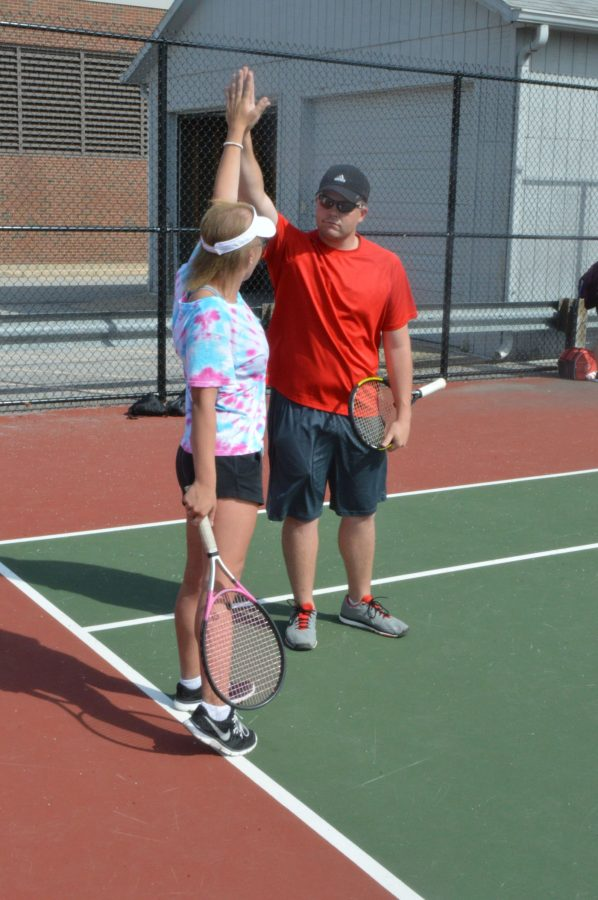 Tennis+coach+Jordan+Cross+high+fives+senior+Kaileigh+Thomas.+Cross+will+be+leaving+SHS+after+his+first+year+as+tennis+coach+to+help+with+his+family%27s+business.+