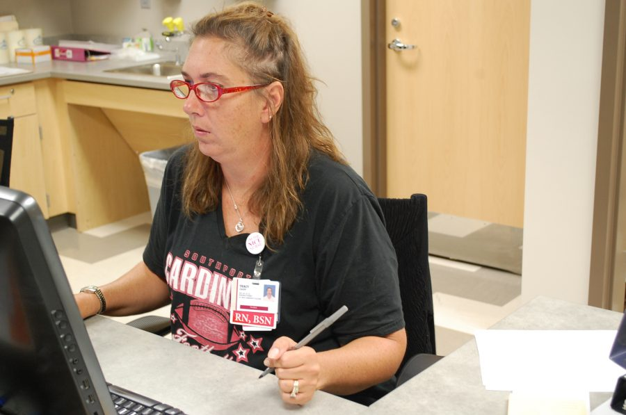 Nurse Tracy Chupp works at her desk on Sept. 9. Chupp thinks the form will help with organization of student health information.