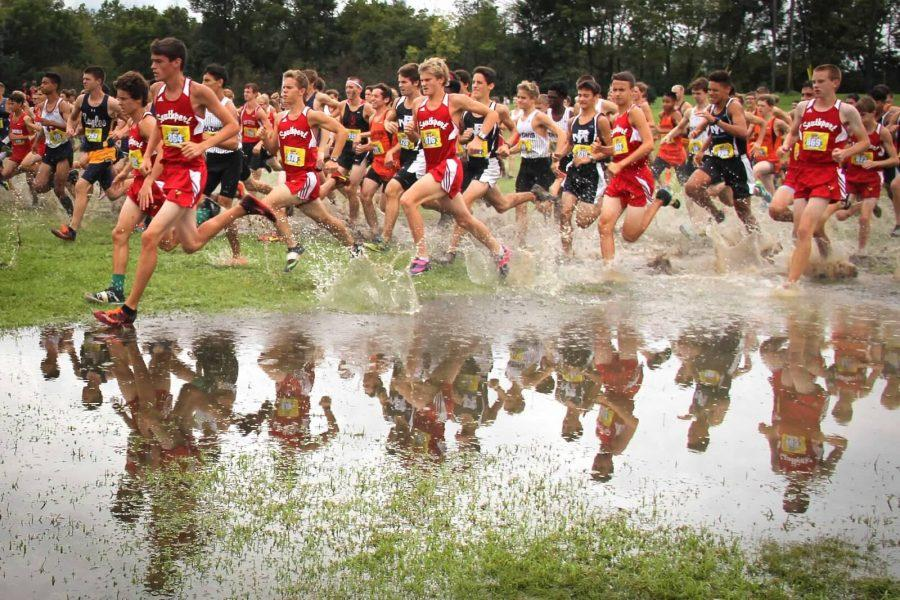 SHS starts the meet by running through a flooded field several meters after the starting line.