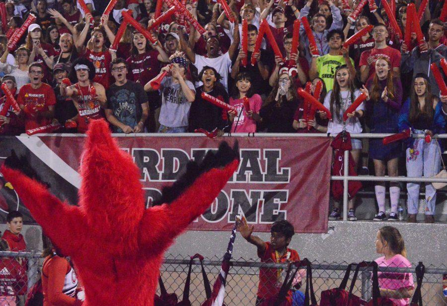 SHS+cardinal+pumps+up+the+crowd+during+the+football+game.