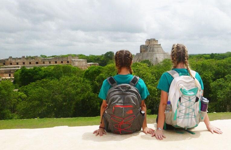 Junior+Jaclyn+Speiser+%28Left%29+and+Roncalli+graduate+Katie+McCarthy+%28Right%29+look+out+at+the+view+of+Mayan+ruins+in+Uxmal%2C+Mexico.+Speiser+says+she+had+a+hard+time+transitioning+back+when+she+returned+home+in+Indiana.
