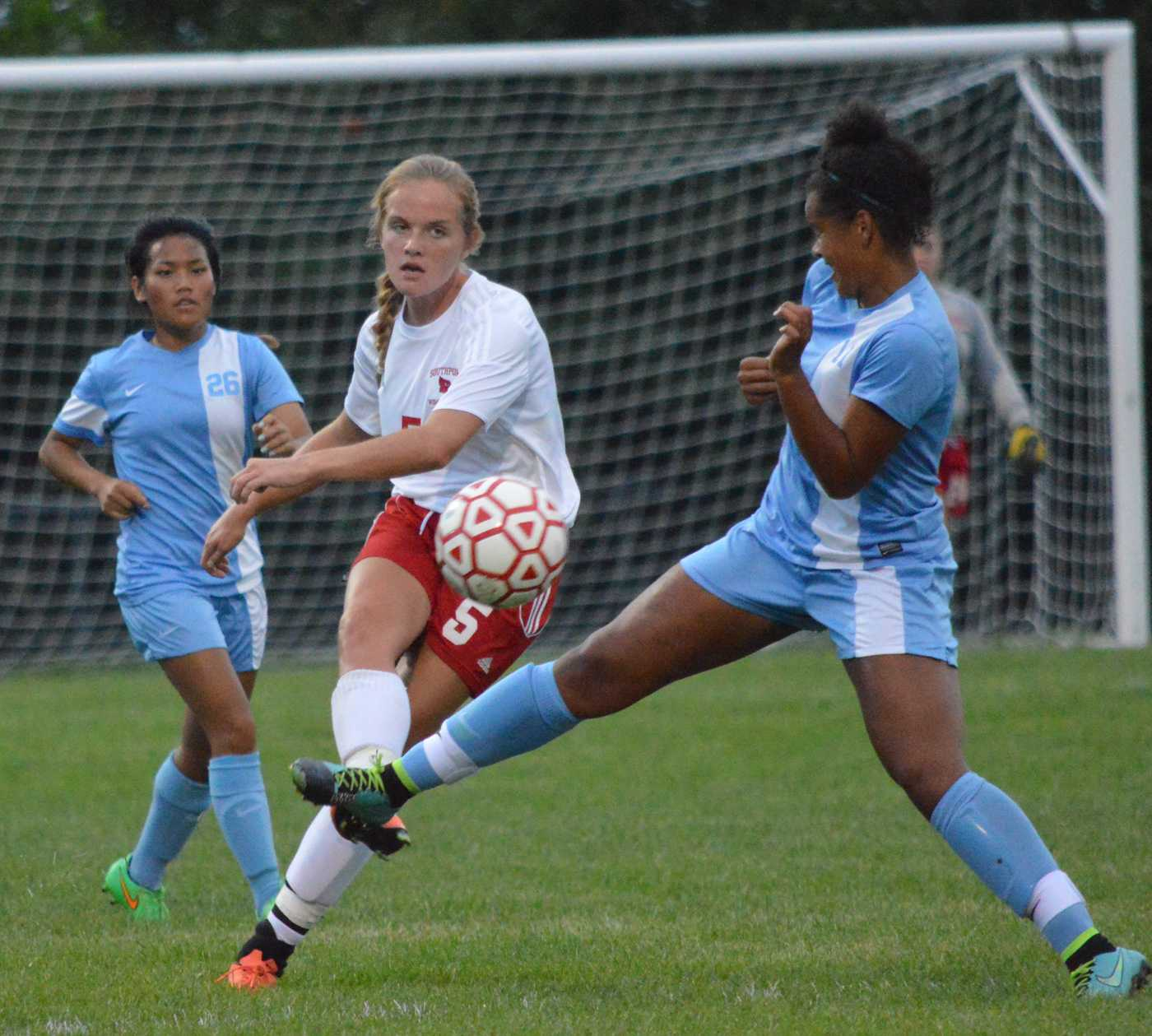 Senior Erin Sullivan defends the ball while going towards the opposite goal. Sullivan is one of the leading scorers this season.