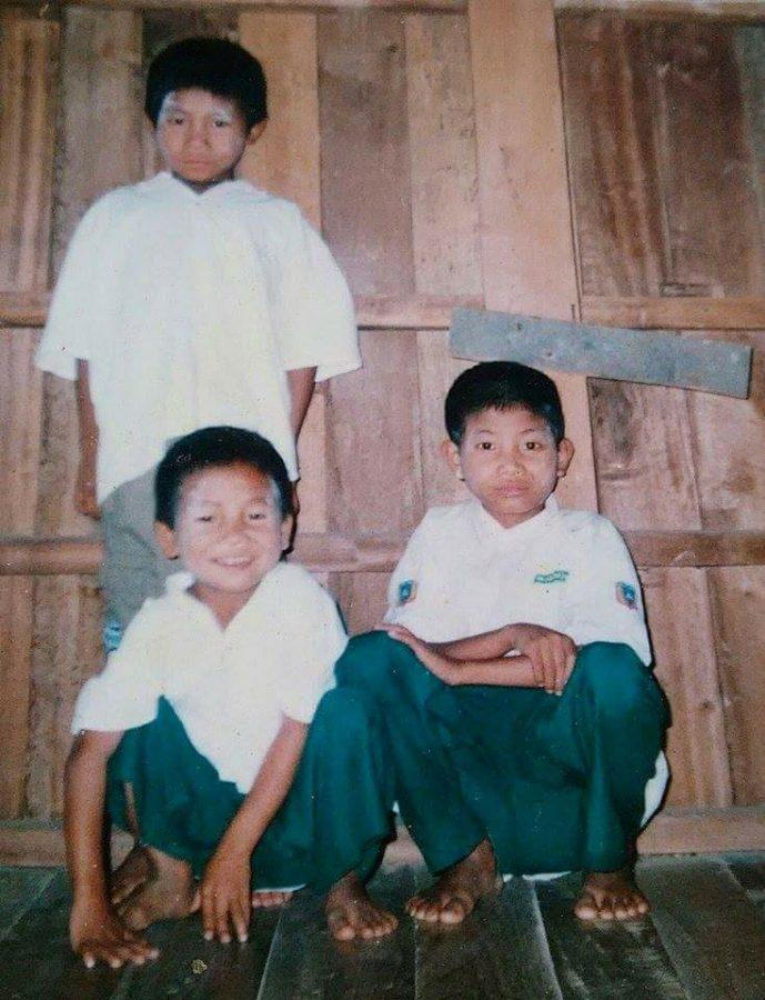 (Top Left) Junior Ring Te poses with his two other brothers at their home in Burma. Te was about 7-years-old when this picture was taken.