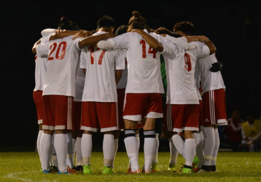 The Cards huddle before the game begins. They take the win by 2-0 against Decatur Central.