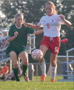 Senior Erin Sullivan shoots the ball in a game on Aug. 27 against Greenwood. She scored the tying goal seconds later