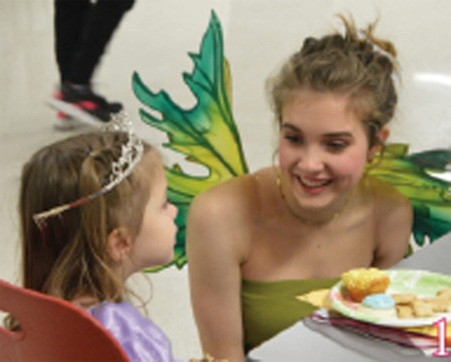 SHS alumni Alaina Speiser, or tinker bell, is enjoying tea with a princess.