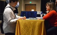 Senior student from Missouri, Charles Roberts, completes a form for information about George Manson University on Nov. 11, 2016 at the JW Marriot in downtown Indianapolis. Several colleges and universities were offering information about journalism and media programs that are offered at their schools.