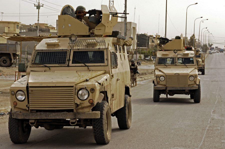 Iraqi army soldiers from 1st Battalion, 4th Brigade Combat Team, 2nd Iraqi Army Division patrol a street in Mosul, Iraq, Feb. 18, 2008. (U.S. Air Force photo by Staff Sgt. Jason Robertson) (Released)
