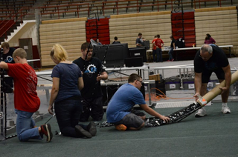 The+SHS+Robotics+team+getting+ready+for+the+CAGE+match.+This+was+the+first+CAGE+match+for+some+members+and+for+Coach+Snodgrass.