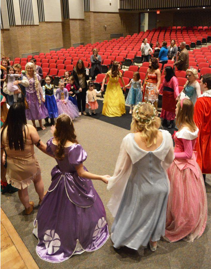 All of the princesses and children gather in a circle and dance together toward the end of the last day of the annual Tea with a Princess.