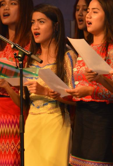 Senior Elizabeth Sung (Left) leads the praise and worship service on Dec. 3 at her church, Chin United Pentecostal Church.  Junior Zing Hnem (Right) sings with her church choir on Dec. 10 at Indiana Chin Baptist Church.
