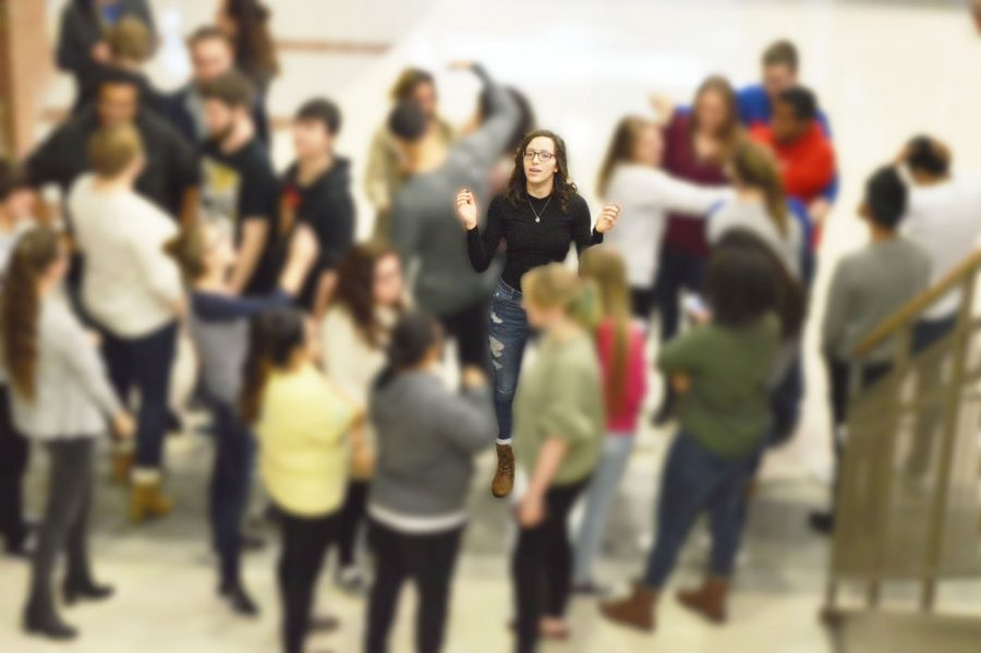 A student is caught trying to tank her way through a crowd of students blocking the main hallway.  This is a daily struggle for students.