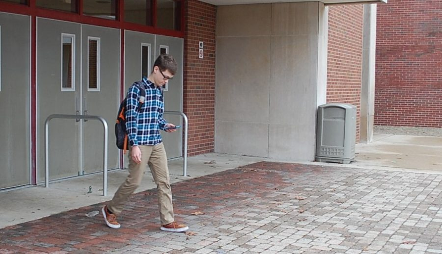 Senior Hunter Taylor walks to his car to leave school on Jan.18 after third period, when School to Career students are released. In School to Career, students are required to work a minimum of 20 hours each week.