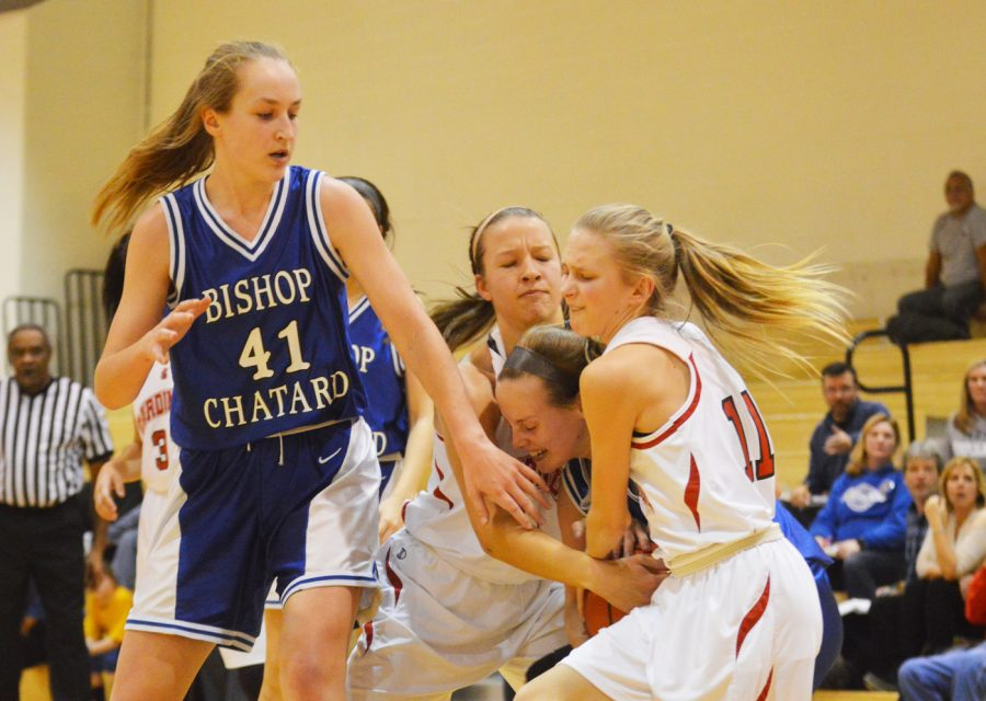 Freshmen Bella Green and Vanessa Miller attempt to steal the ball from a rival team player.