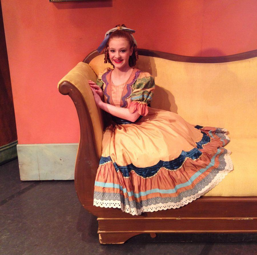 Freshman Julia Brookshire poses on a couch while wearing her costume for her performance in Butler University's