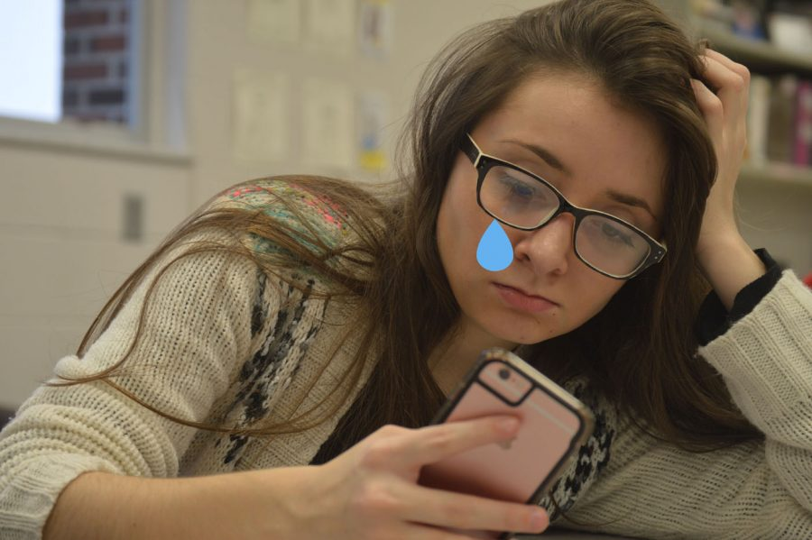 """Senior Emily Nettick is caught being """"totally uber emotional"""" while reading tweets about George Michael's death.  Nettick proceeded to explain to multiple different users who Michael even was after looking it up herself minutes prior."""