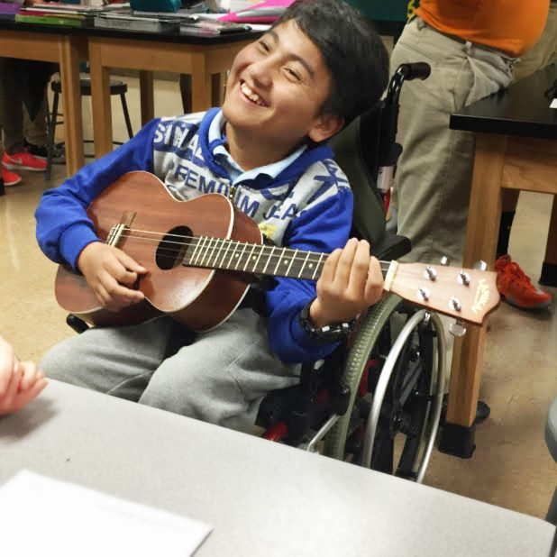 Freshman Kam Mang plays the guitar when he was a student at SMS. Mang passed away on Dec. 14 due to a degenerative nervous central disorder.